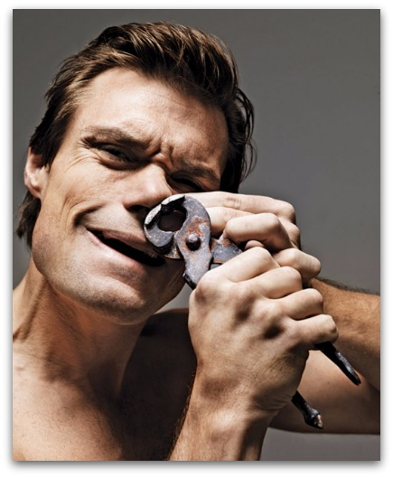 Man using a plier to remove nose hairs